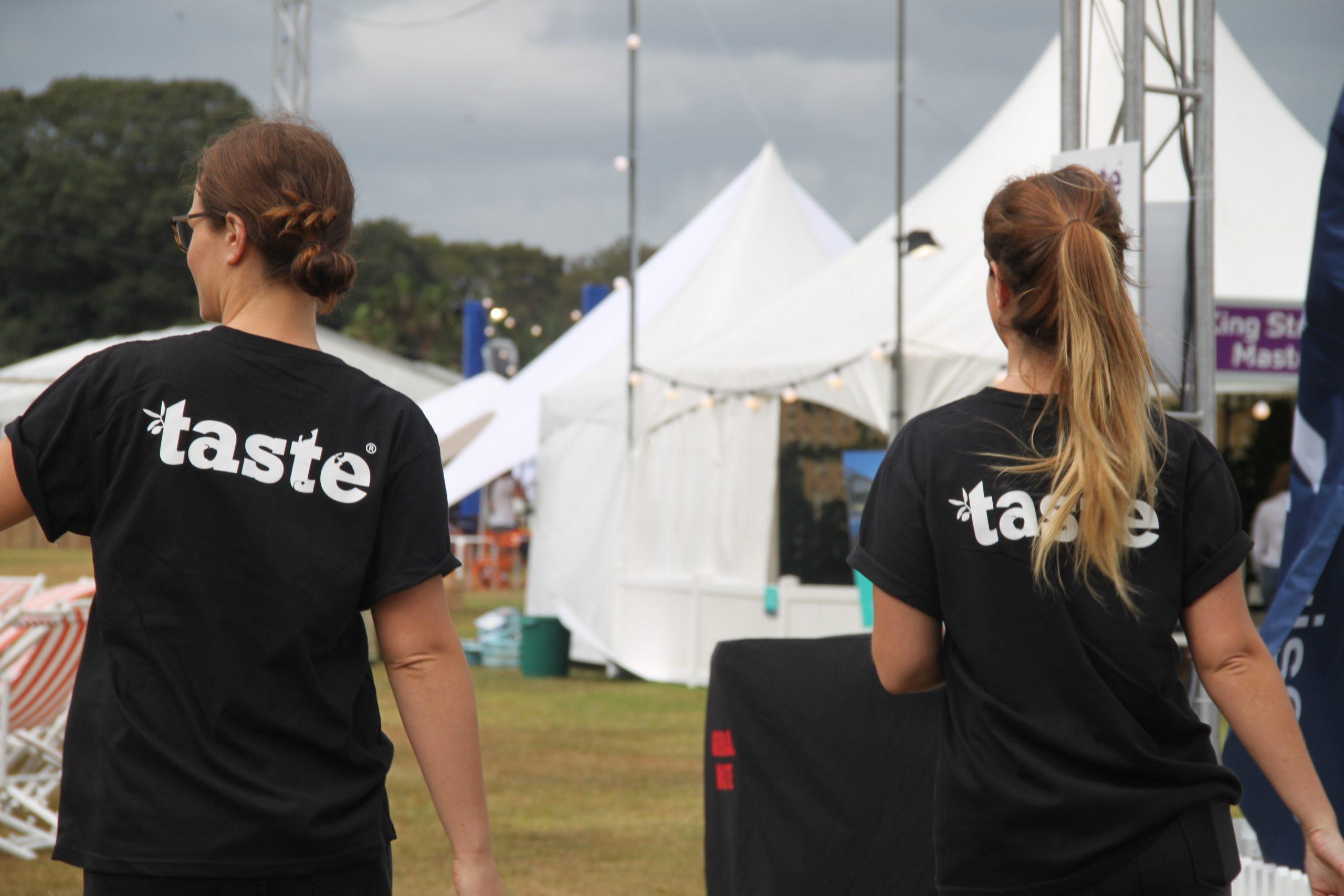student volunteers in black TASTE T-shirts