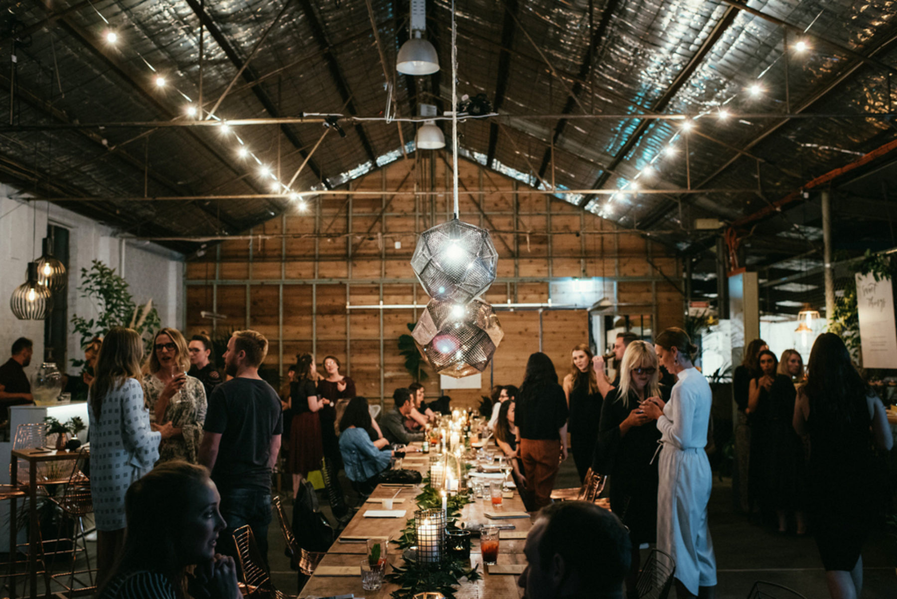 A modern barn turns into an event venue when lighting and table settings are aded