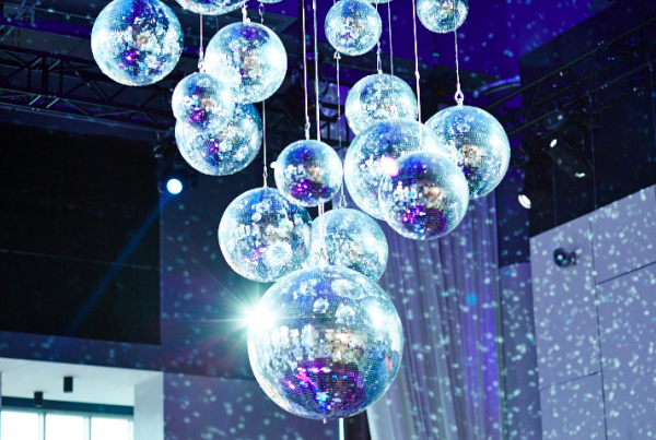 Many mirror balls hanging from the ceiling at a night event by Event Emporium