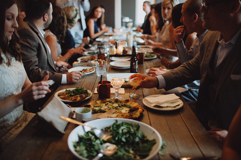 Events bring joy. A bunch of friends at a dinner table sharing a meal
