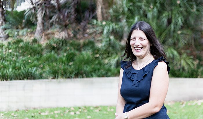 Outdoor shot of Event Educator Ilana Larke laughing in park
