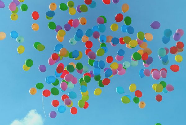 colourful balloons floating into the sky depicting inspiration