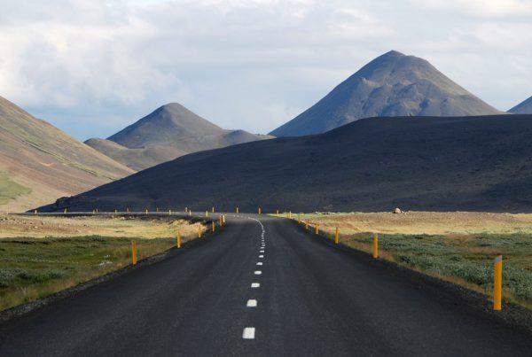 Long deserted road depicting a long career journey