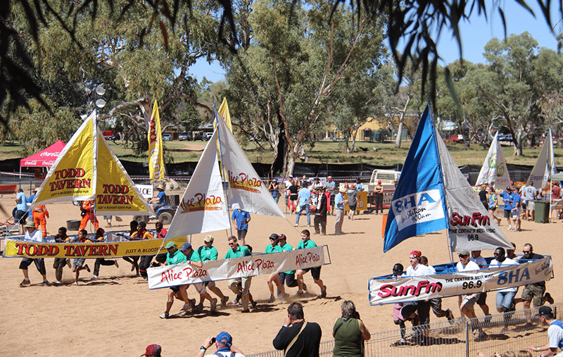 Teams competing in desert boat races
